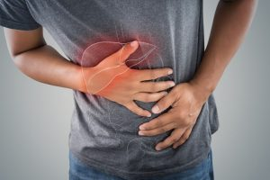 Male suffering from gallbladder pain