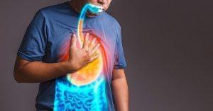 Guy suffering from heartburn